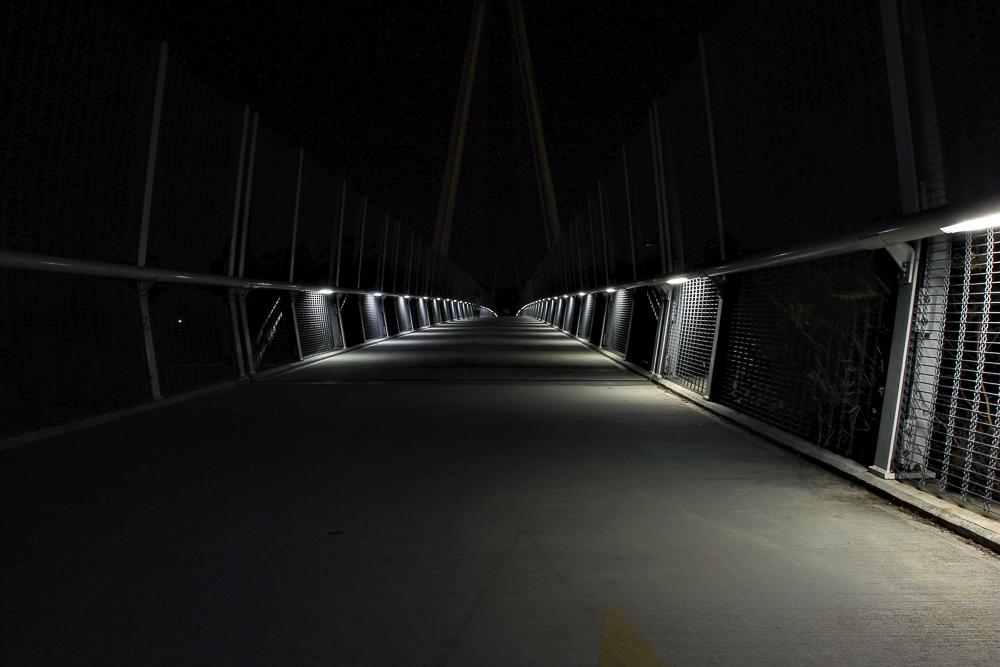Lit pedestrian bridge at night Cupertino, CA