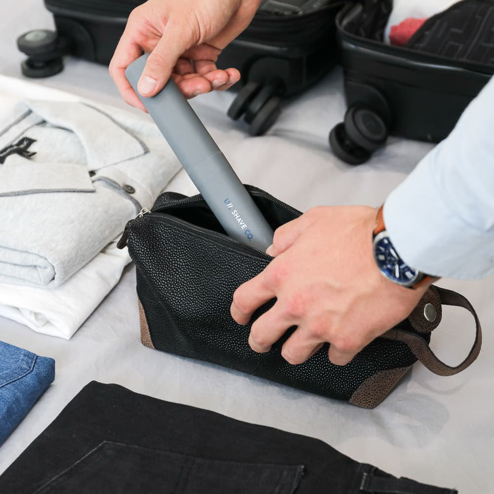 Man packing toiletries bag for travel