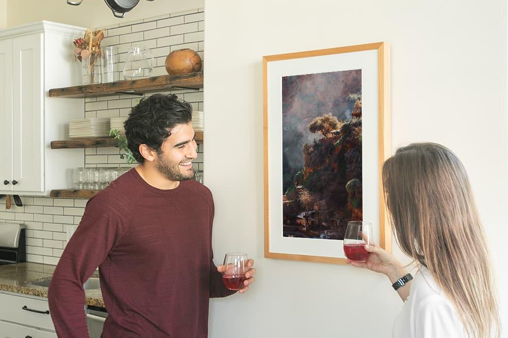 Couple viewing Canvia digital smart art frame