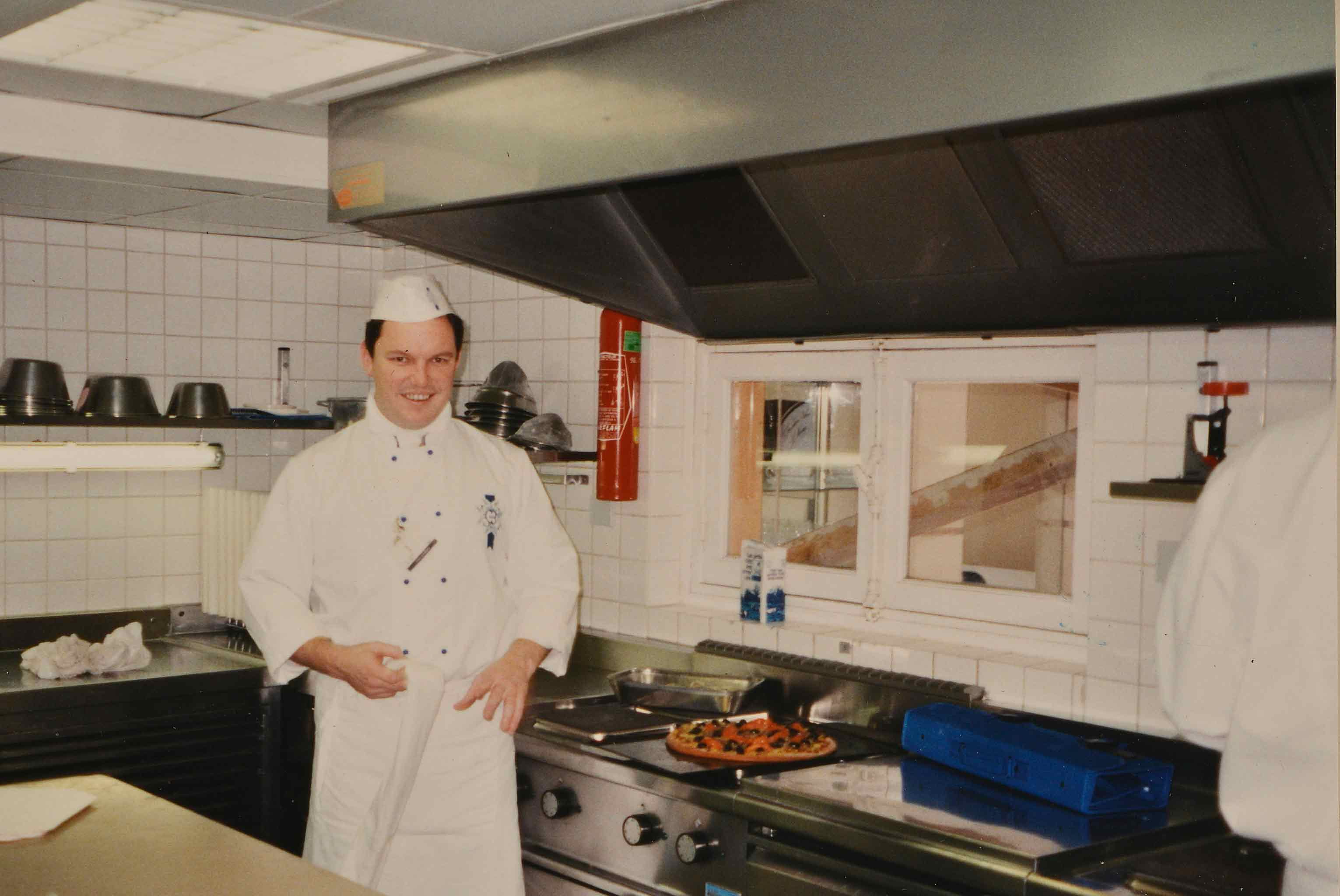 Dr Rod as chef in kitchen