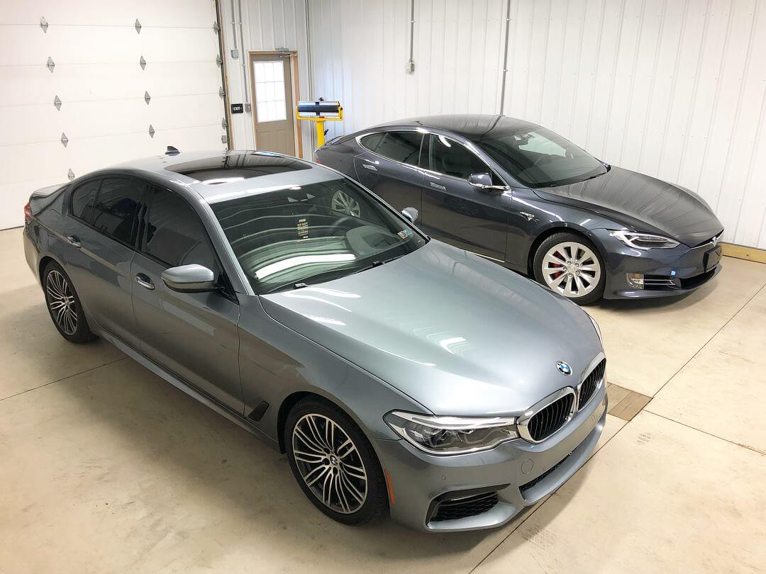 BMW and Tesla after window tint installation in Pittsburgh