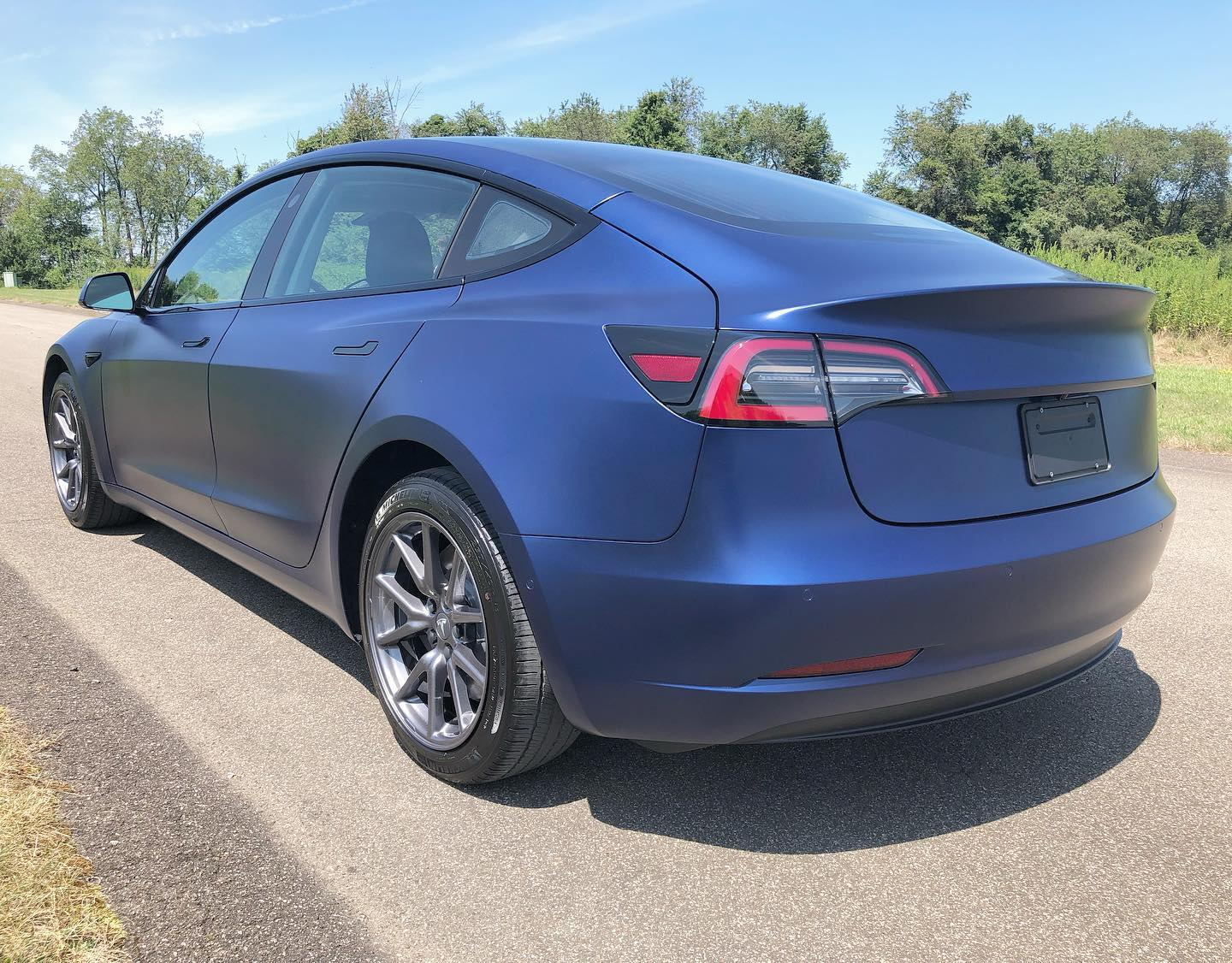 Tesla wrapped with blue XPEL Stealth film