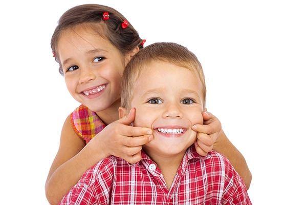 Children showing teeth
