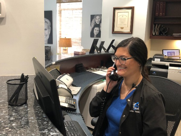 Receptionist speaking to a patient on the phone