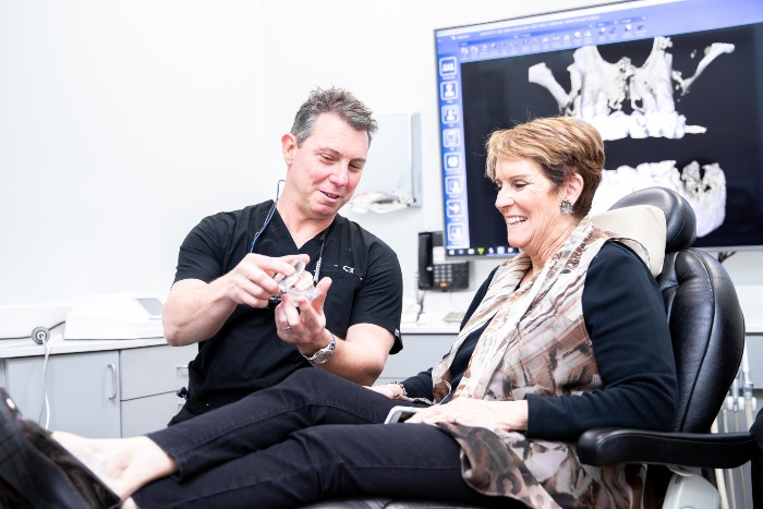 Dr. Schof and a patient discussing her smile
