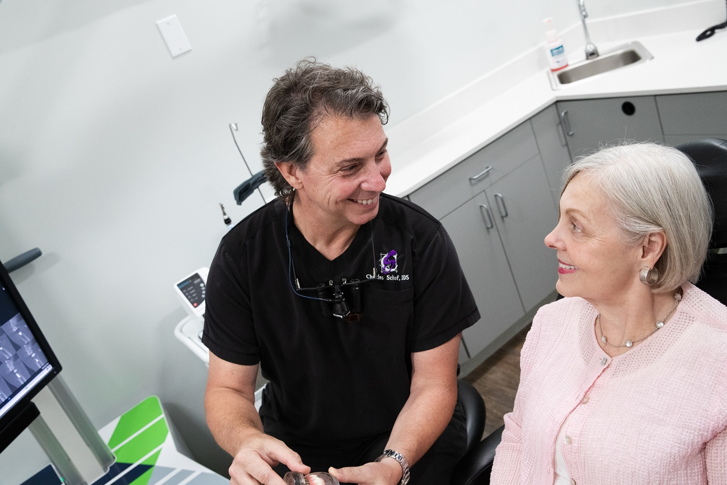 Dr. Schof speaking with a patient about teeth whitening