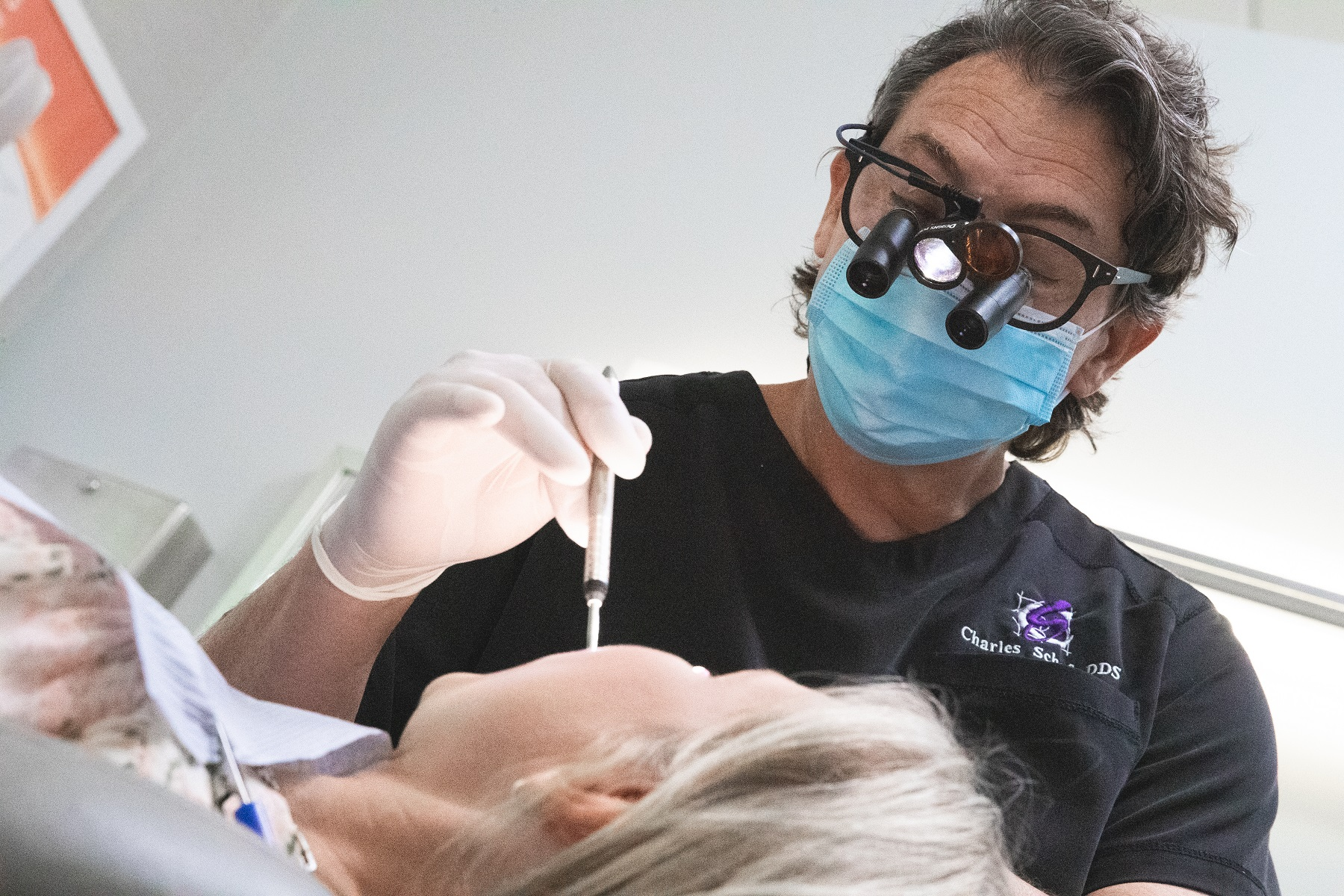 Dr. Schof working on patient with dental emergency