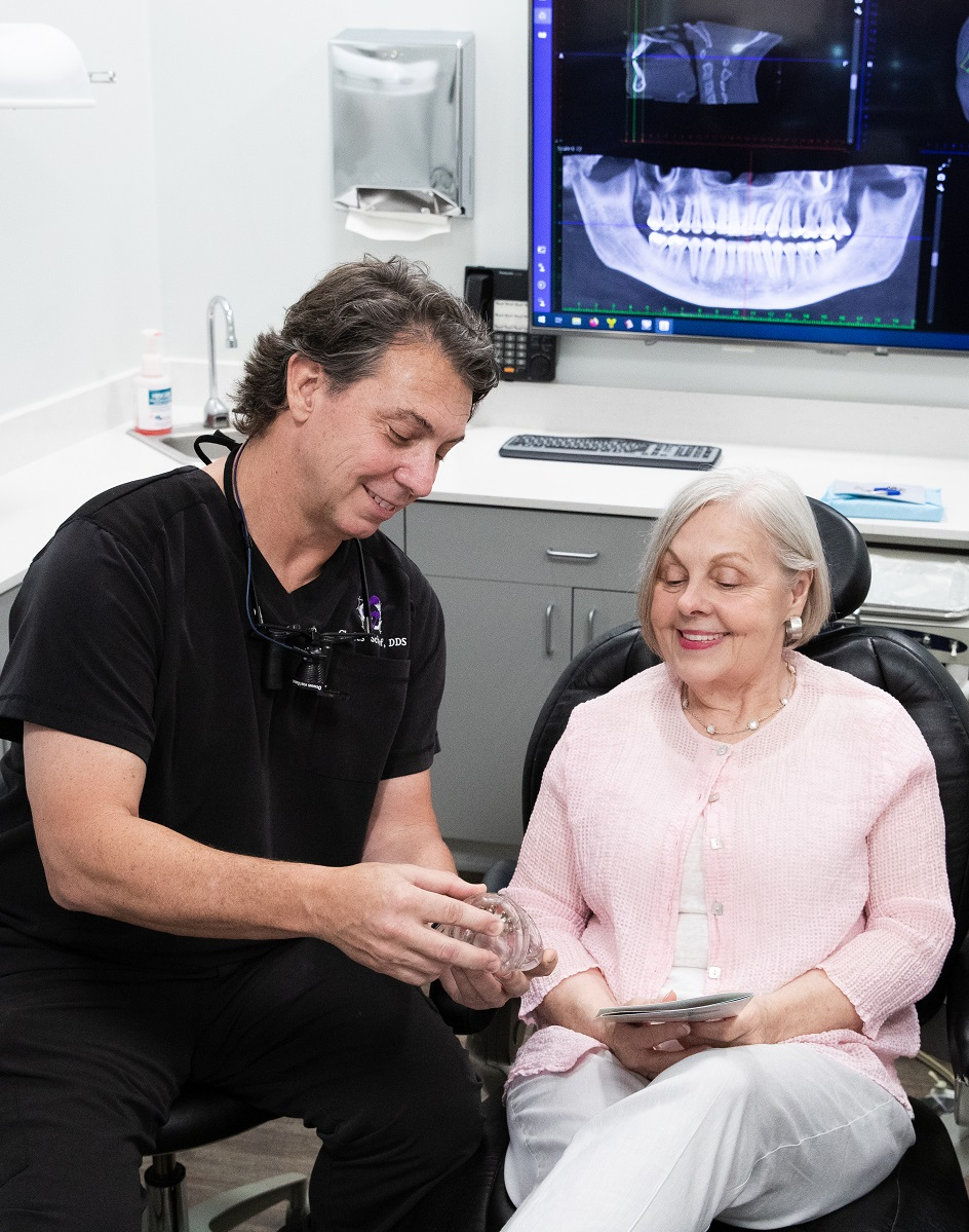 Dr. Schof with patient in Mandeville
