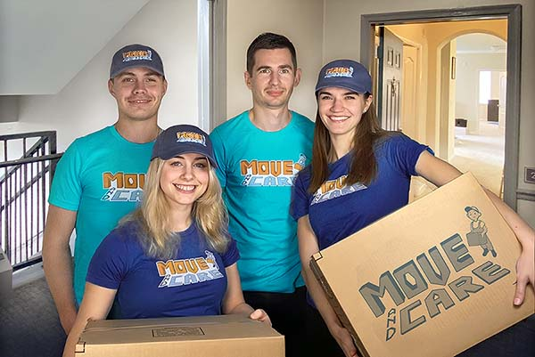 Move and Care team holding boxes
