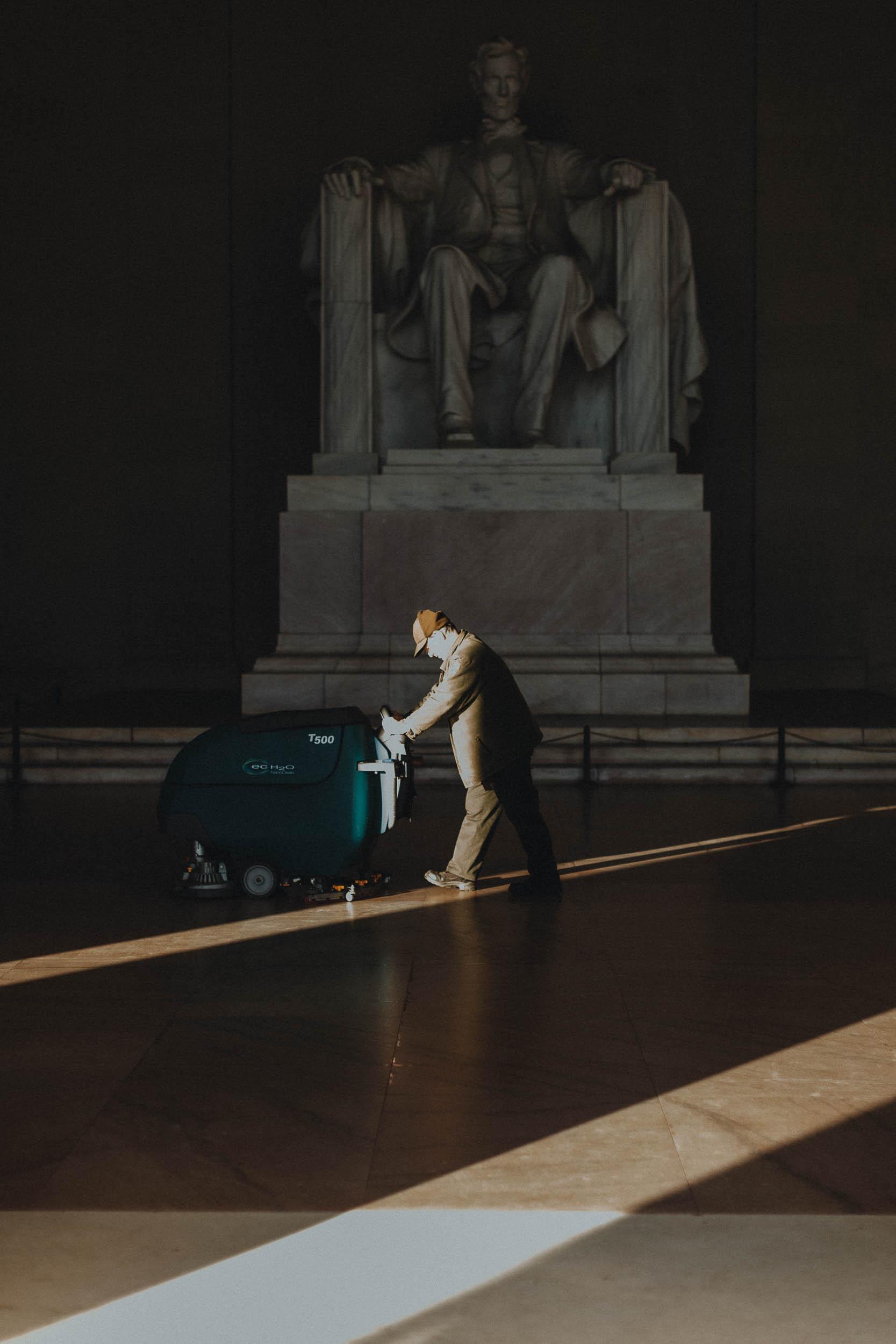 A an waxes the floor of the Lincoln Memorial