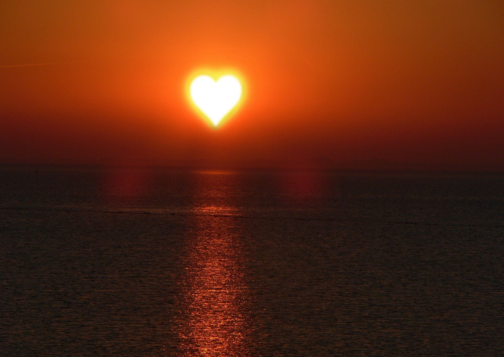 Setting sun in the shape of a heart