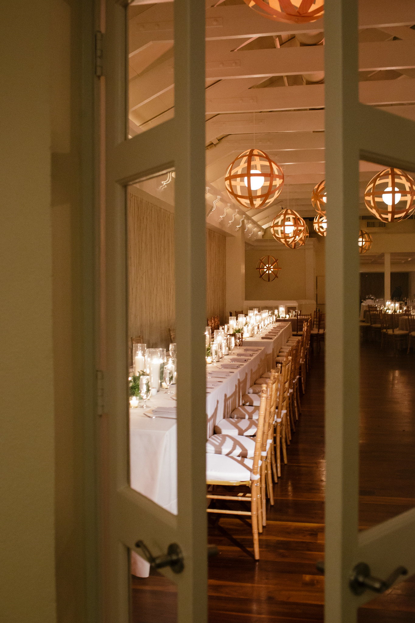 Table setting with wild flowers and draped lighting hanging overhead.