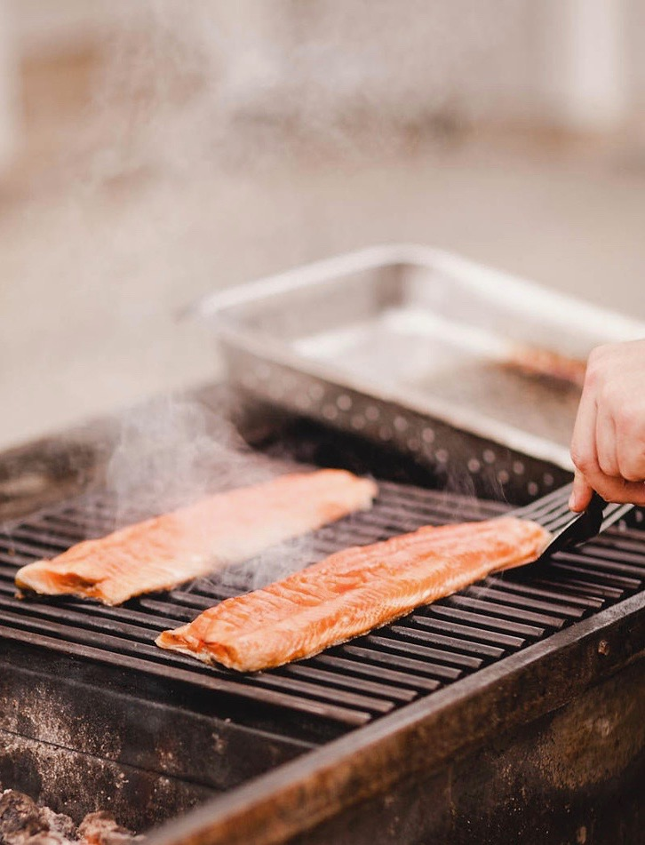 Fresh salmon on a grill.