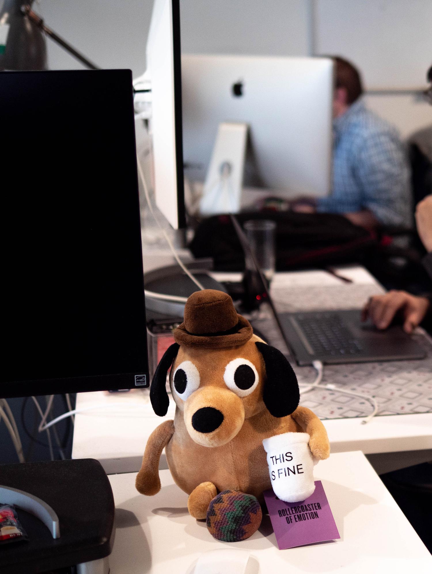 A stuffed animal on a desk