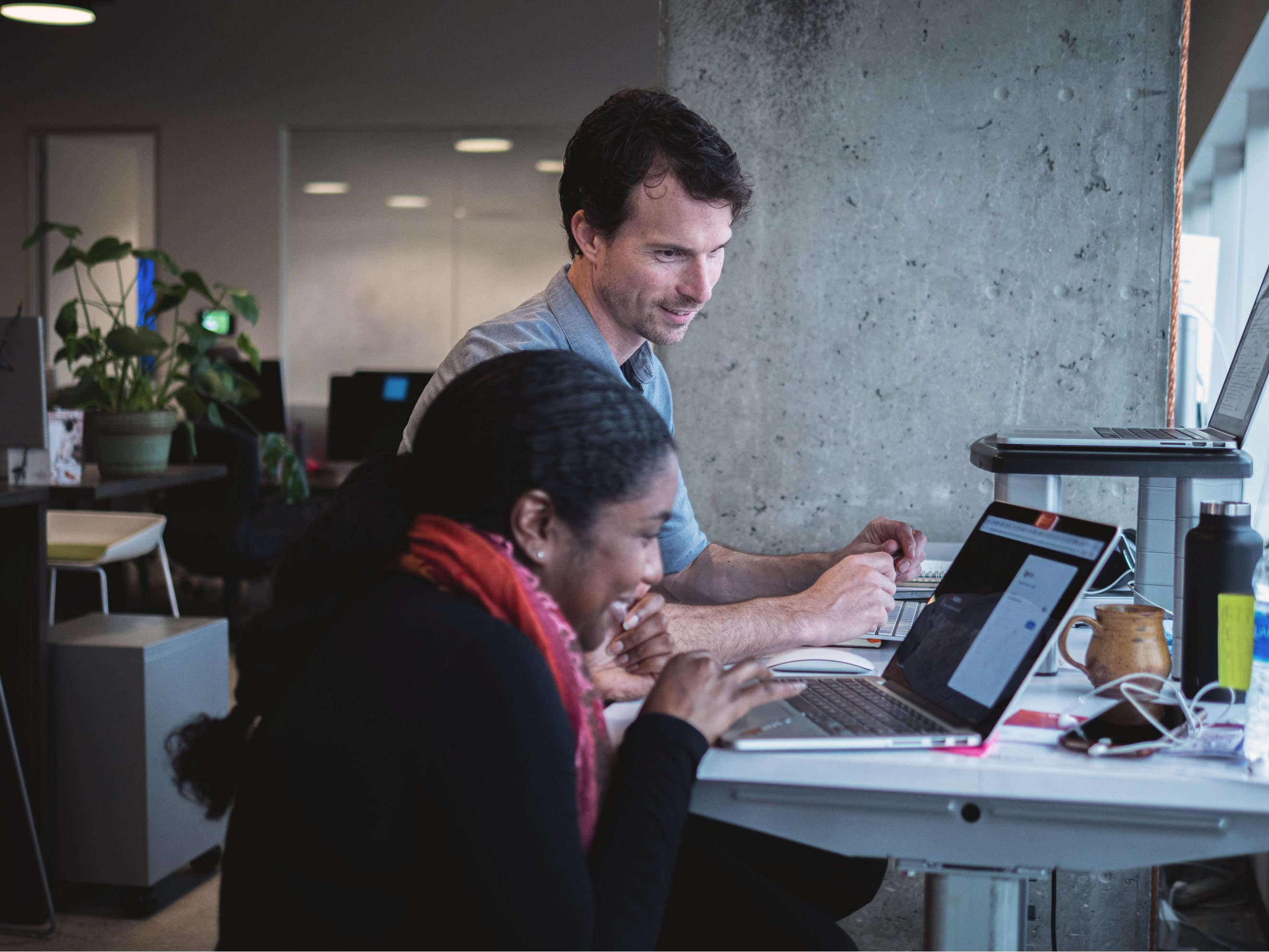 Two poets working at a computer