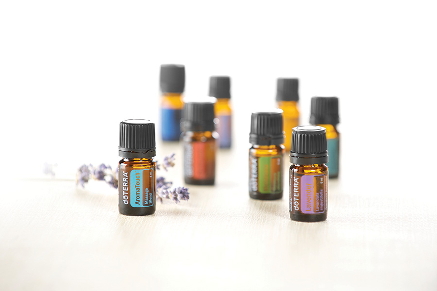 various essential oils on a white background