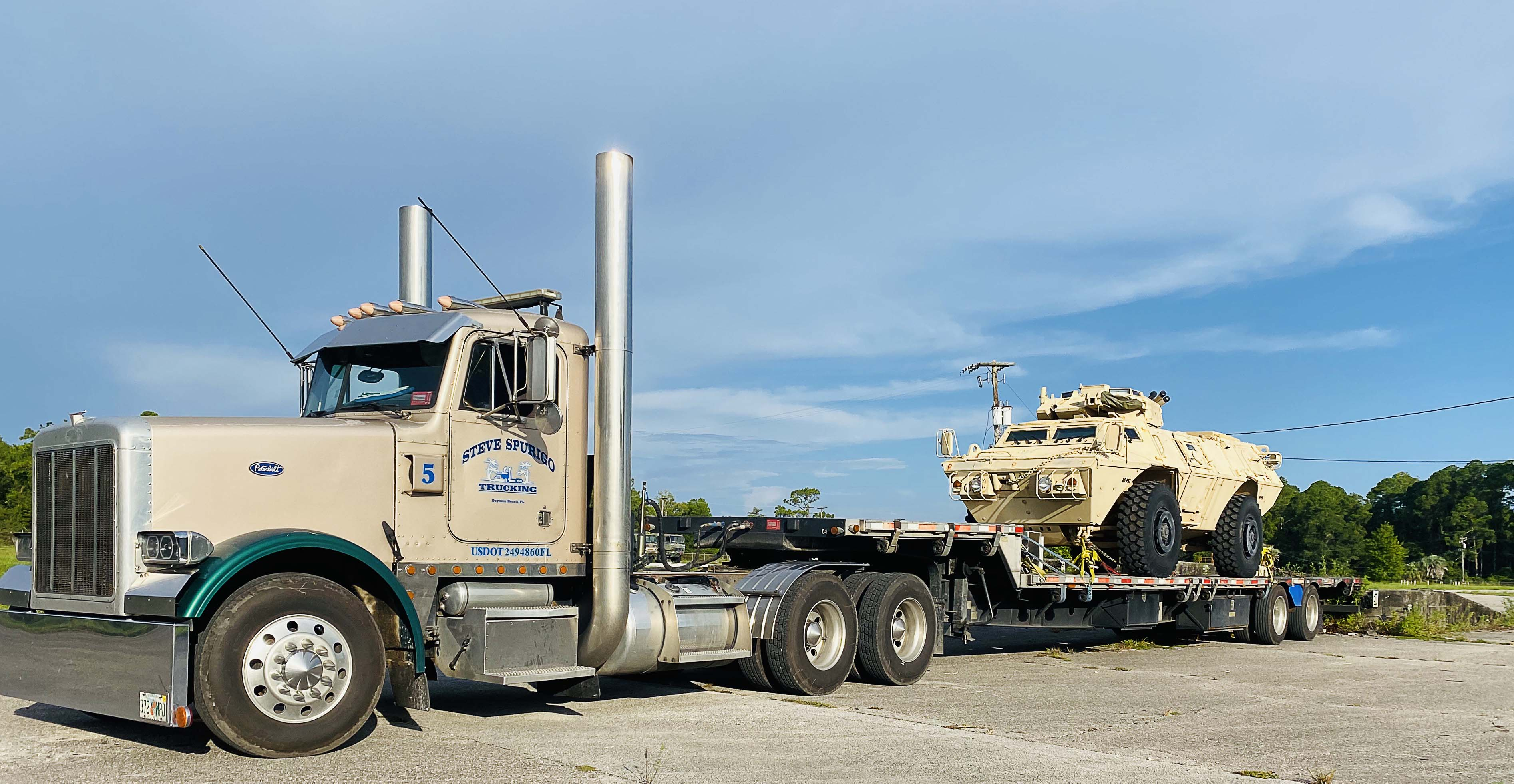 An oversized vehicle hauls a troop transport