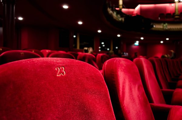 red theater chairs with gold embroidered numbers