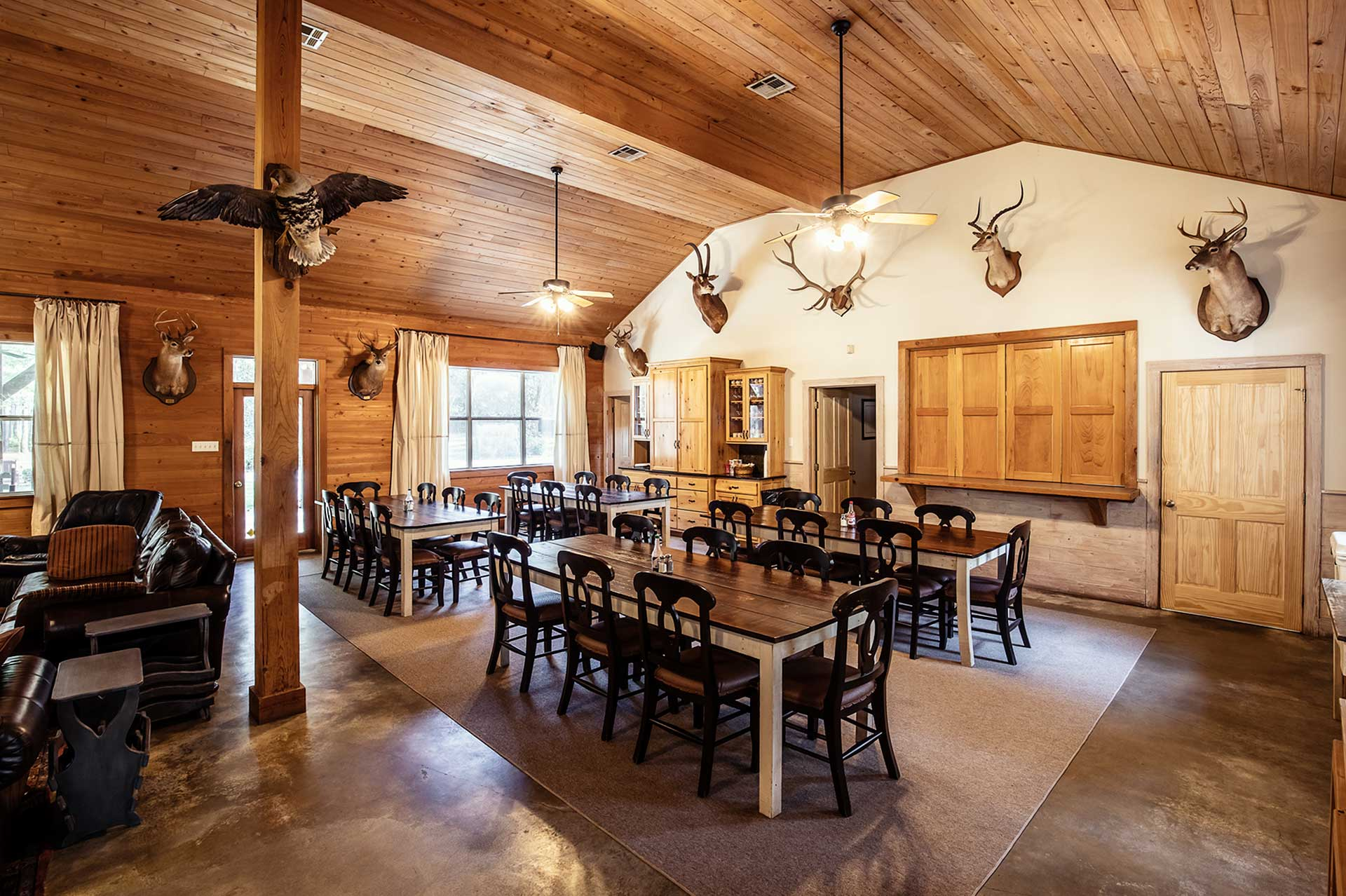 The interior of Covey Rise Lodge's main lodge cabin with table and chairs.