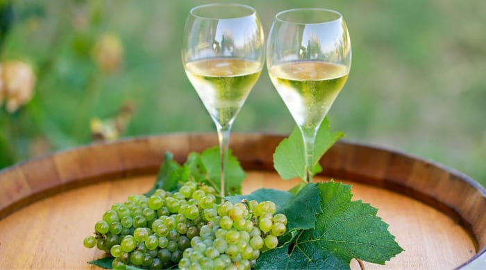 How does the fermentation process influence the flavors of Chardonnay?