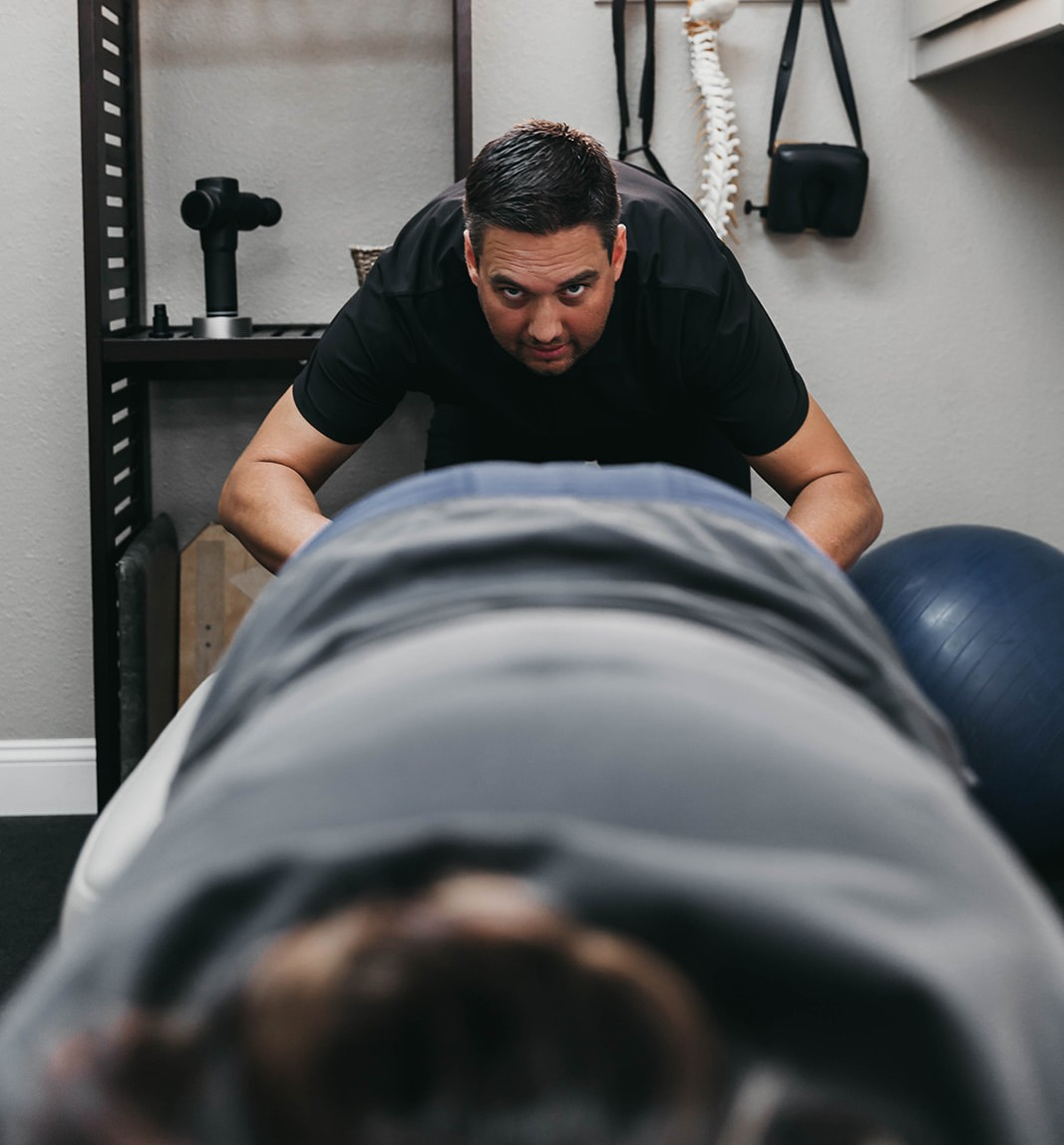 Dr. Beau looking at someone's back alignment