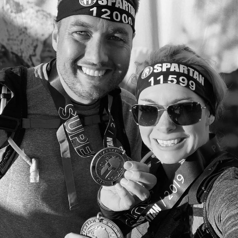 Dr. Beau and his wife after finishing spartan race