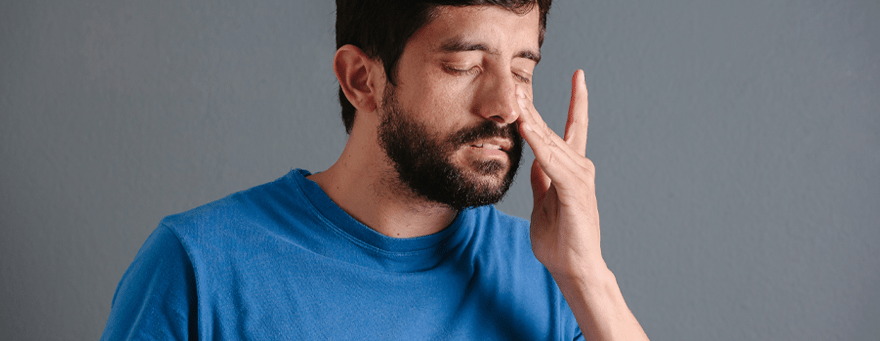 Man suffers from sinus pain as a result of recurring infections