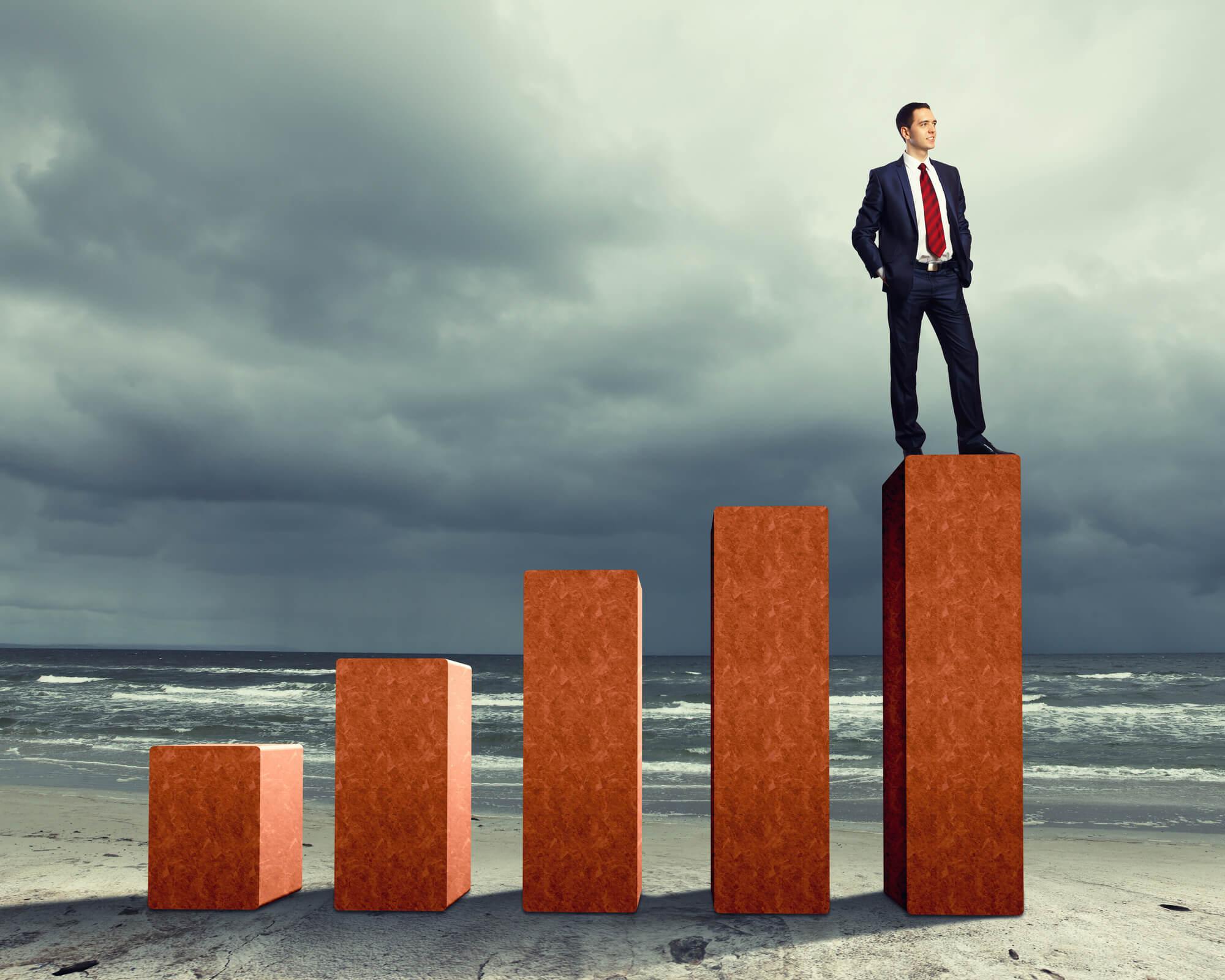 businessman-standing-on-success