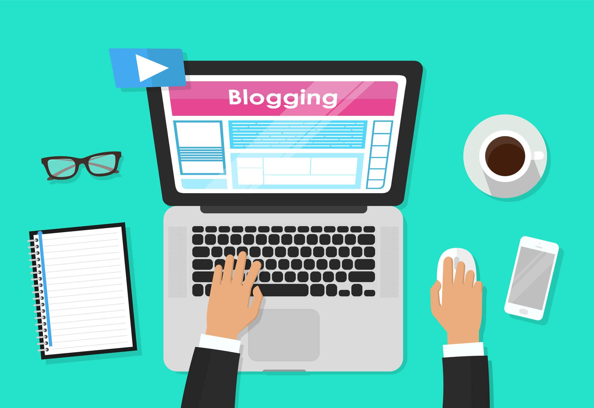 businessman-blogging-on-laptop