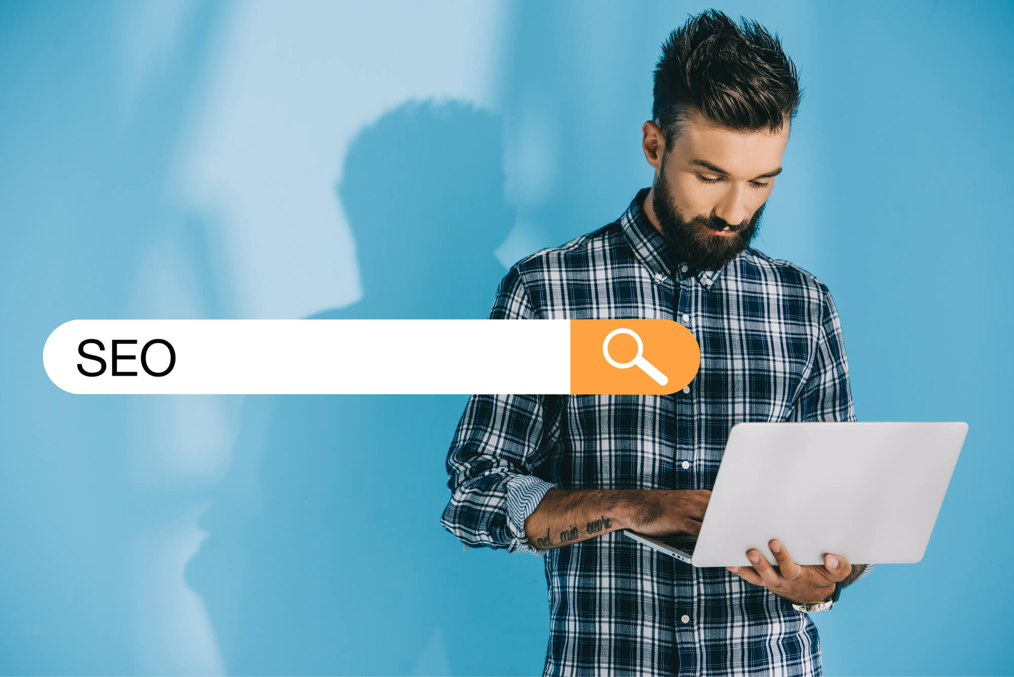 man-holding-laptop-searching-for-seo-online