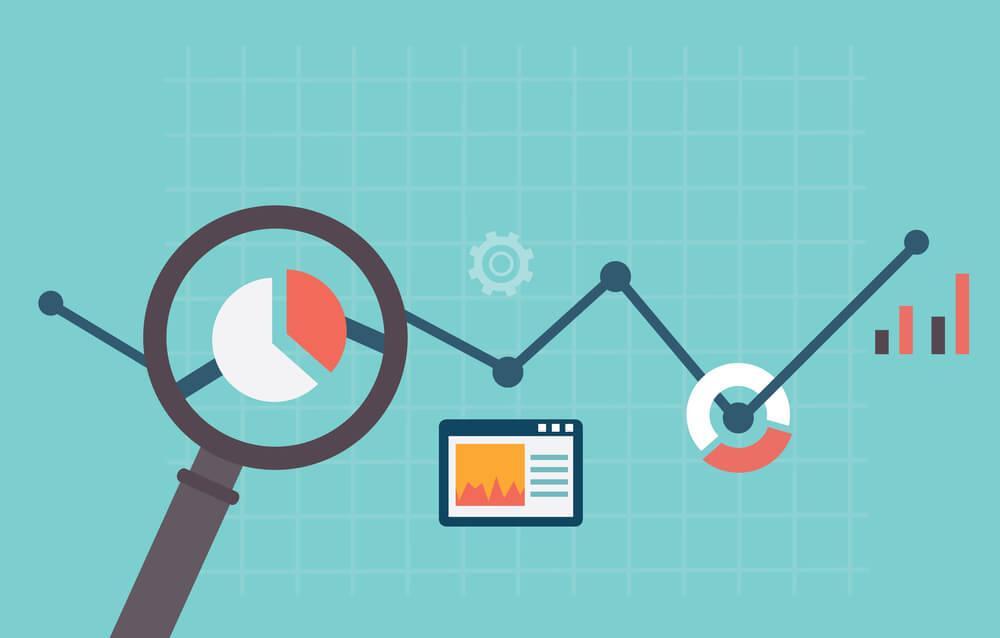 magnifying glass analyzing metrics