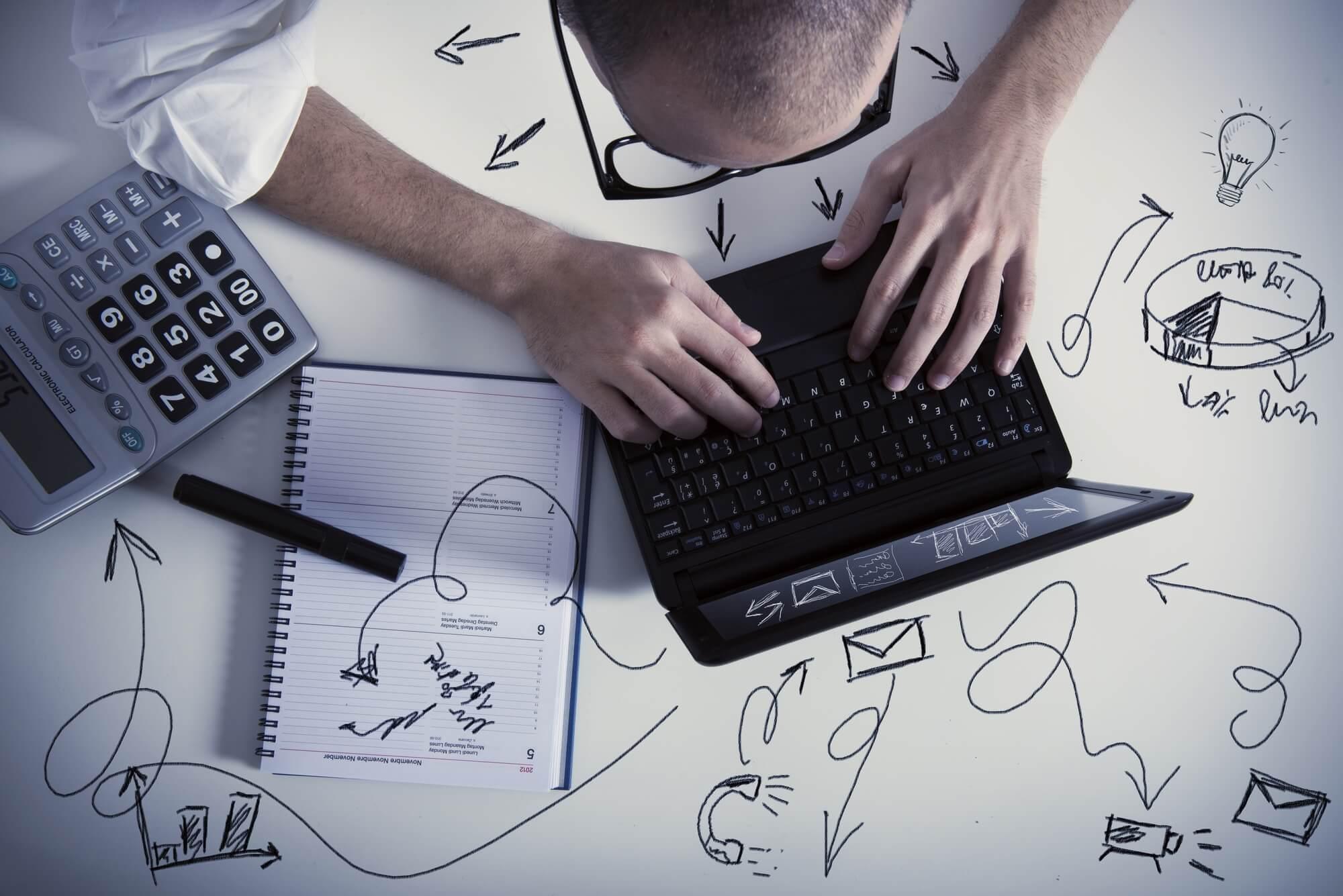 businessman multitasking at work