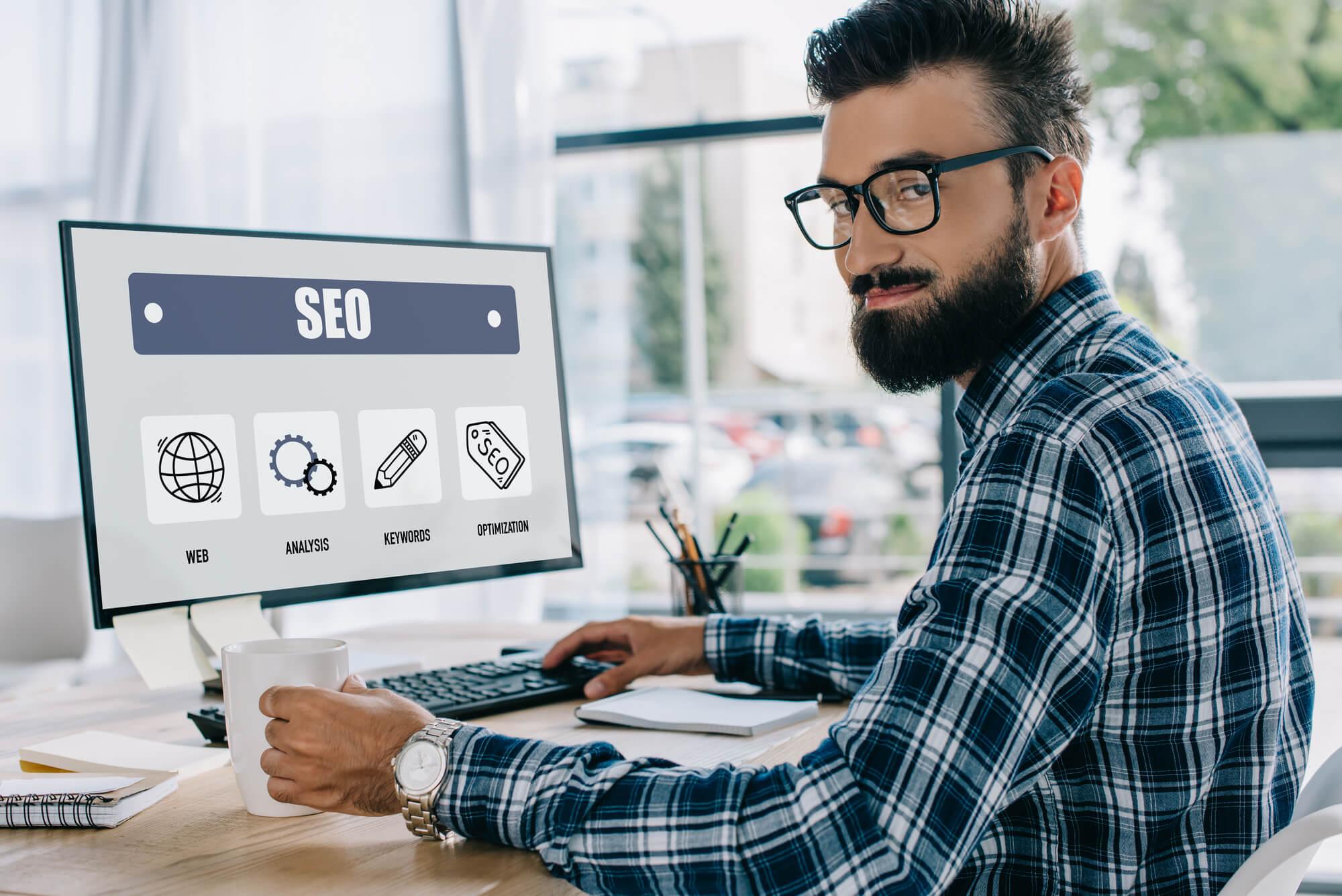 SEO expert in front of his desktop