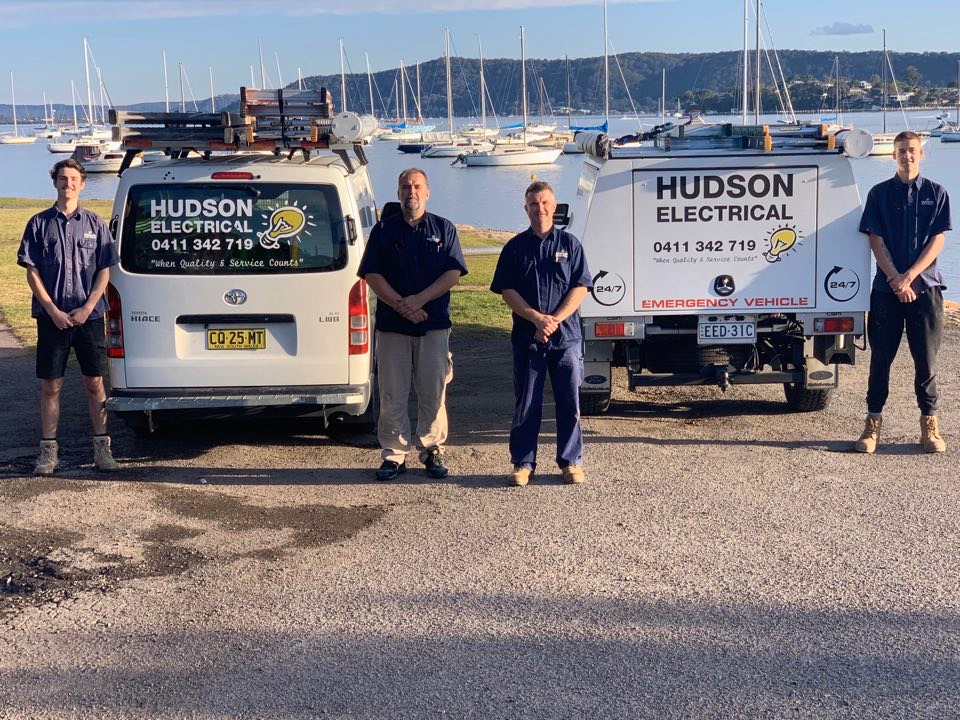 Hudson electrical workers with their company van and ute