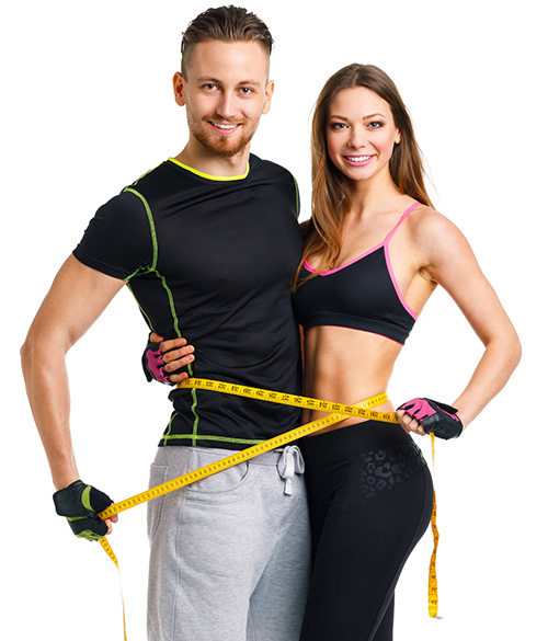 Man and woman in workout clothing wrapping tape measure around their waists