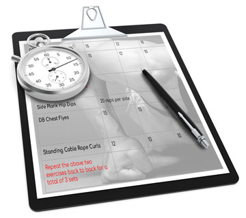 Clipboard with workout routine, stopwatch and pen