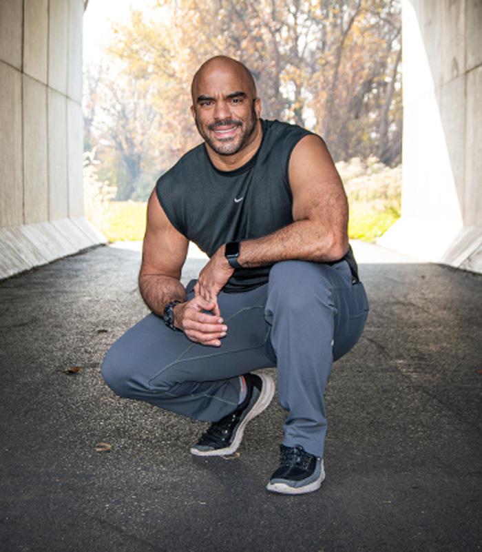 Josh Zitomer crouching in tunnel smiling