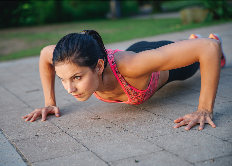 Woman doing burpees outside