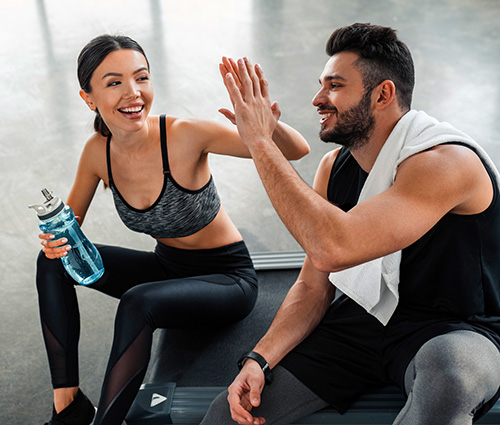 Group of people in workout clothing in exercise class