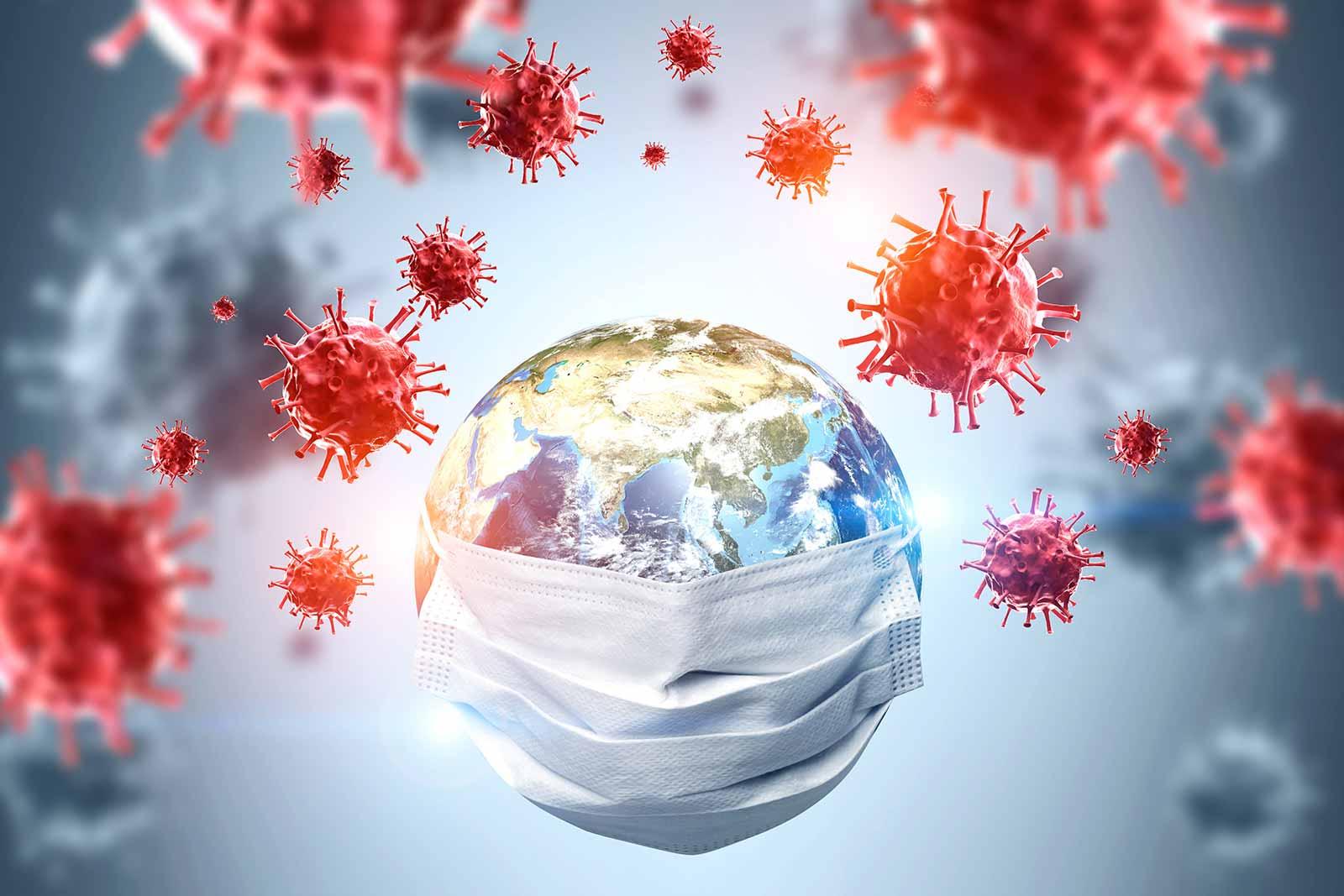 Fotografia ilustrativa do Planeta Terra usando uma máscara e diversos vírus ao redor dele