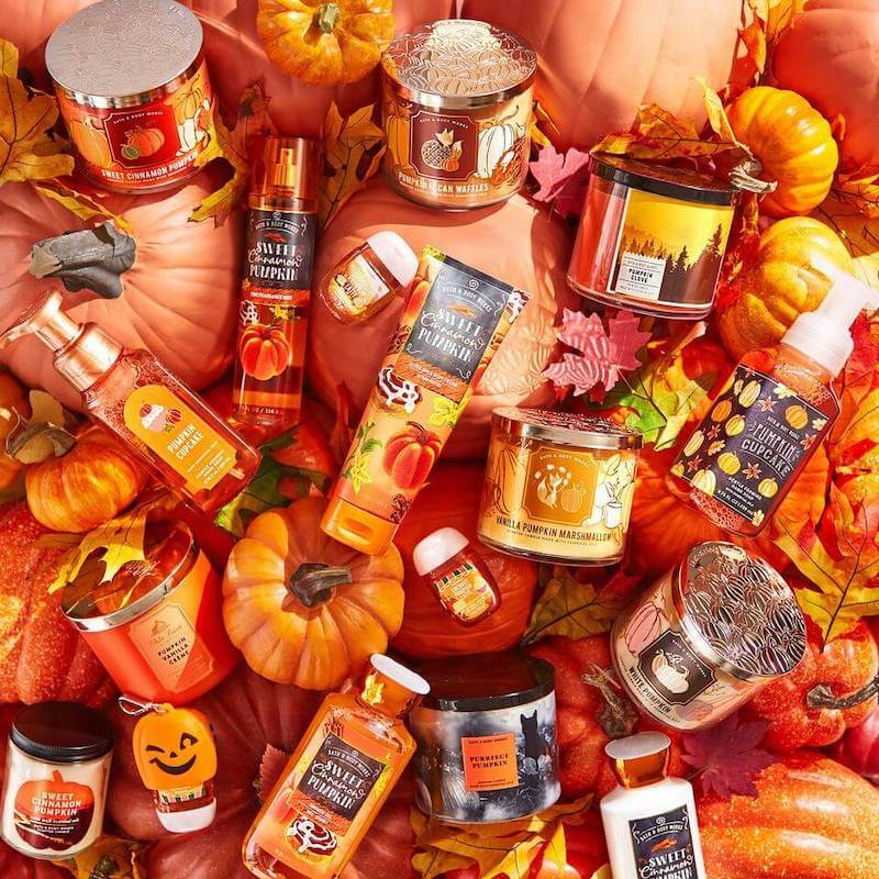 Photo of pumpkin scented products laying on top of pumpkins