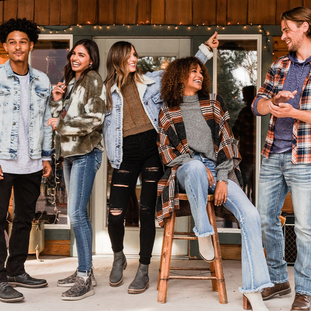 three female and 2 male models on a porch modeling buckle clothing