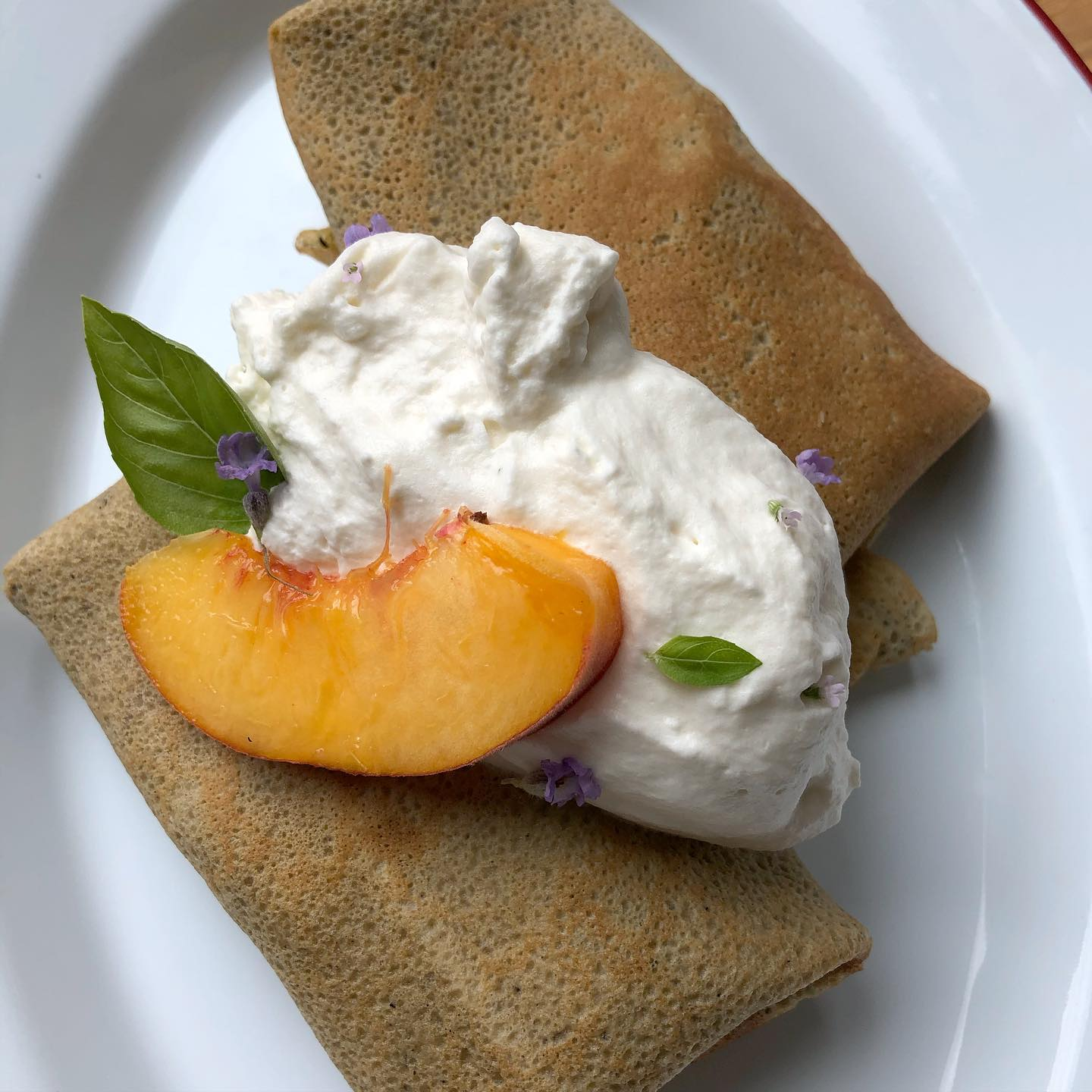 Peaches, Peaches, Peaches. Tis peak season! We serve them sliced in our Brunch Blintzes, with Fig Leaf infused whipped cream, for a mellow nutty flavor. #brunchlife #threespringsfruitfarm