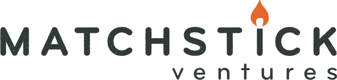"logo for Matchstick Ventures in dark grey and orange with the ""i"" in Matchstick as a lit match"