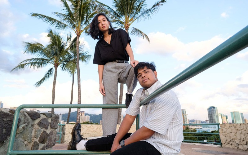 Hawaii indie rock pop duo Ragamuffs hanging out getting some sun under palm trees.