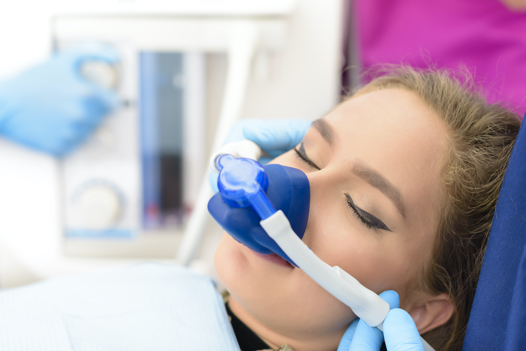 girl using sleep apnea machine