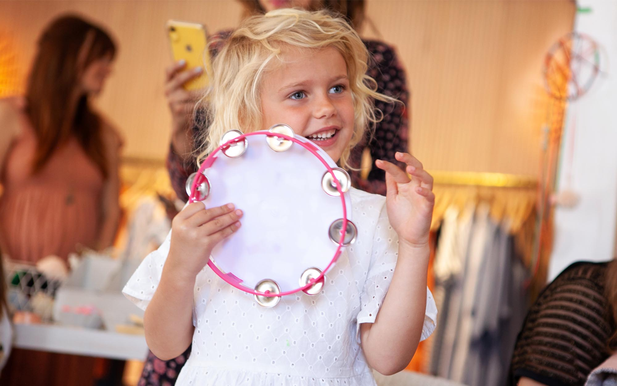 little girl playing the tambourine