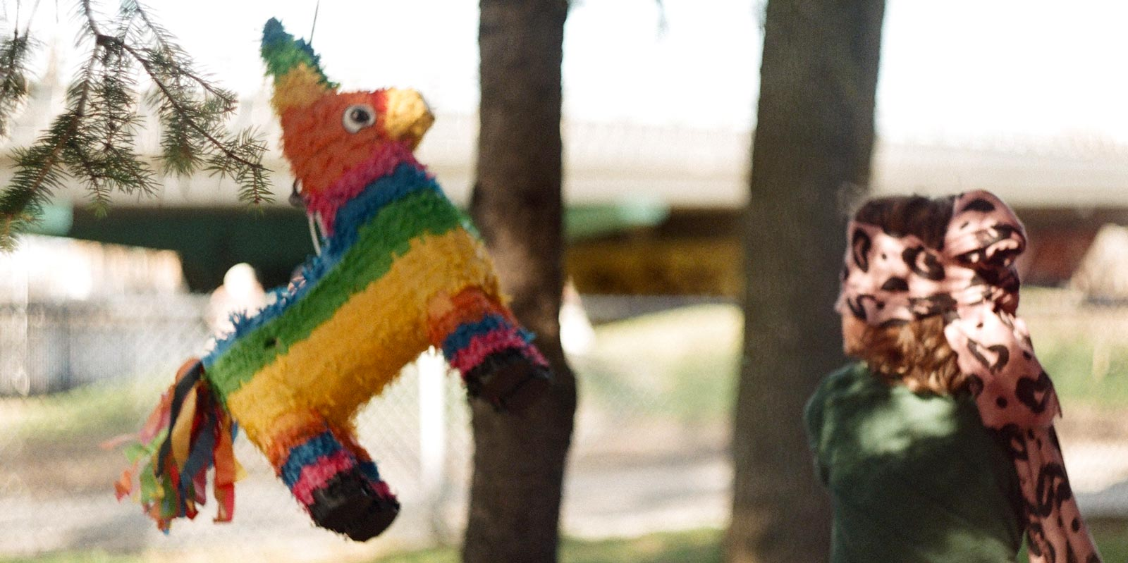 Photo of a child playing with a piñata