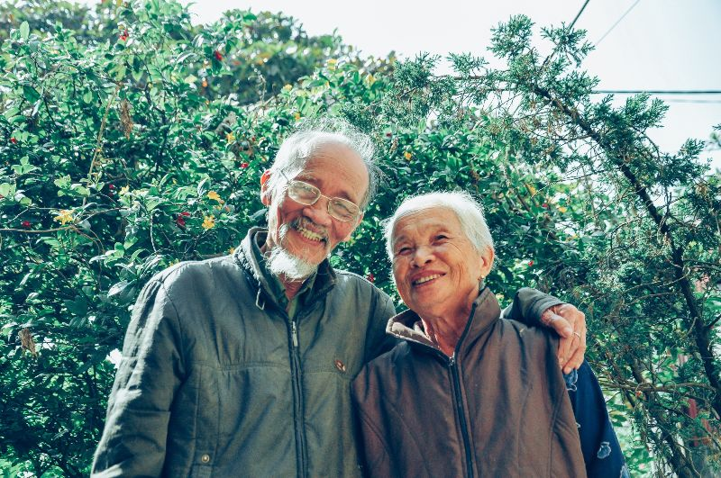 older couple outside smiling
