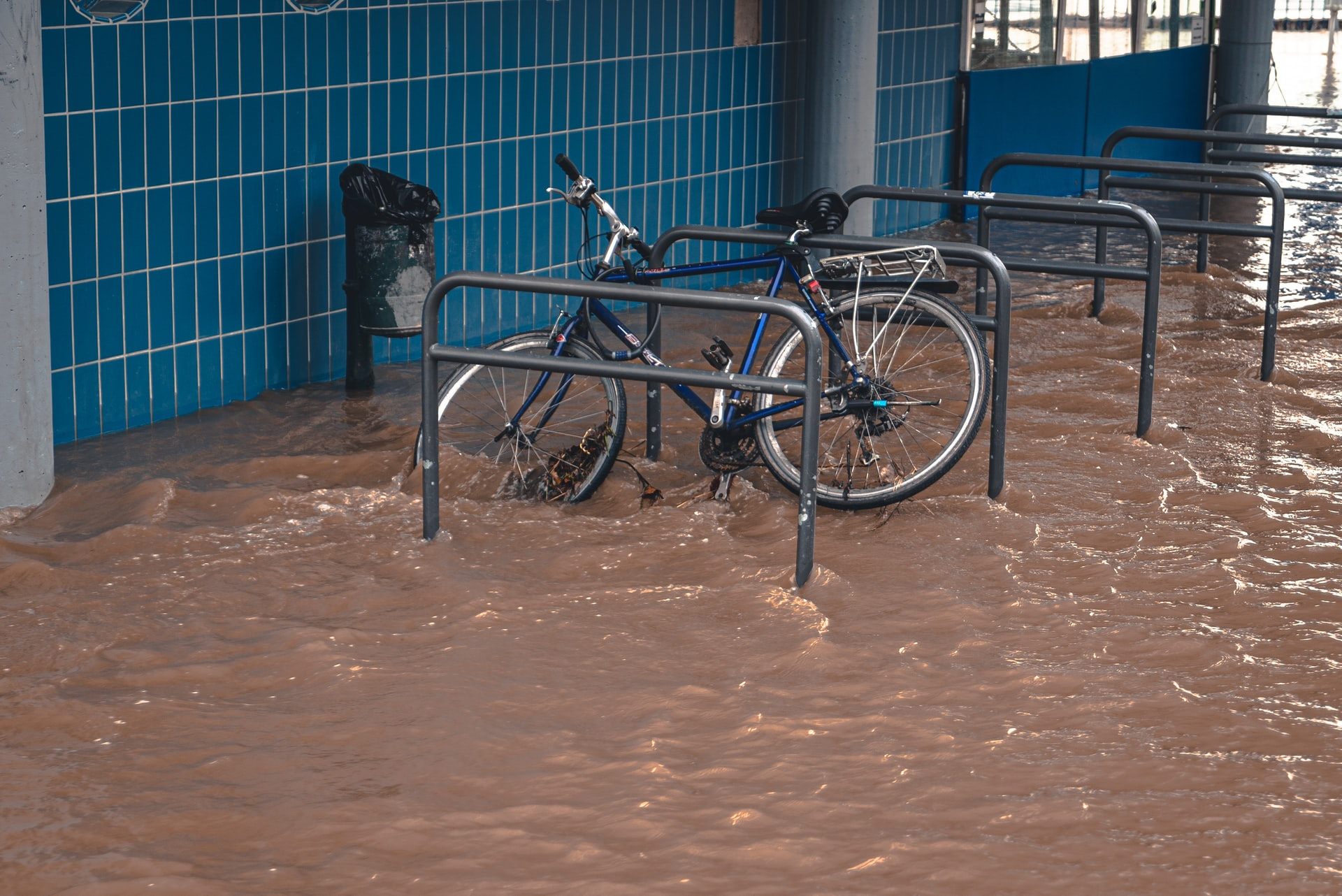 Bike in flooded bike parking area, Photo by Mika Baumeister on Unsplash